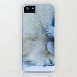 Bear cub plays with mom's paw polar bear. Funny animal close-up. iPhone Case