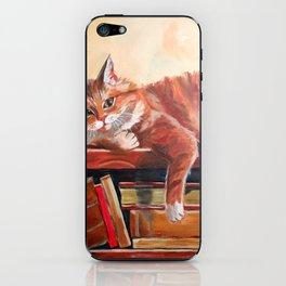 Red cat on a bookshelf iPhone Skin