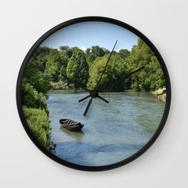 Peaceful river view with boat Wall Clock