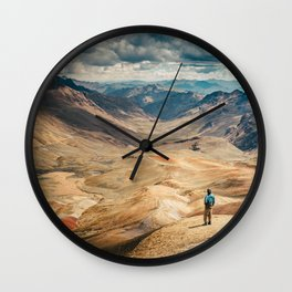 Man front of the mountain Wall Clock