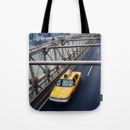 New York Cab with Twin Towers in background over Brooklyn Bridge Tote Bag