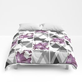 Pink lilies on grey triangles . Comforters
