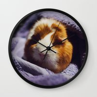 guinea pig Wall Clocks featuring My brothers guinea pig by Jamie de Leeuw