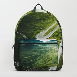 winding road in the faroe islands Backpack