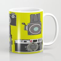 cameras Mugs featuring Cameras by Illustrated by Jenny