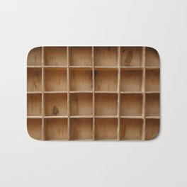 Empty wooden cabinet with cells Bath Mat
