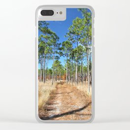 Dirt road through a pine forest Clear iPhone Case