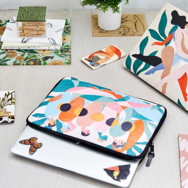desk with colorful phone cases, laptop sleeves and acrylic trays