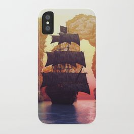 A pirate ship off an island at a sunset iPhone Case