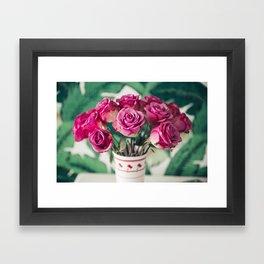 Purple Roses Against Banana Palms Framed Art Print