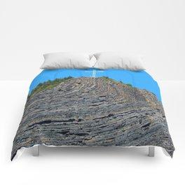 Bent rock Mountain cross Comforters