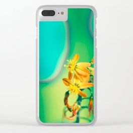 Bulbine flower on green and blue Clear iPhone Case
