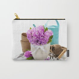 Beautiful Hyacinths in vase and garden tools over white Carry-All Pouch