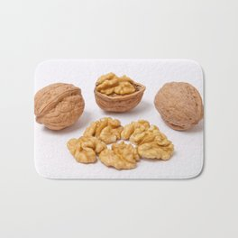 Walnuts and kernels on white background Bath Mat