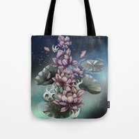 lotus flower Tote Bags featuring Lotus by Marine Loup