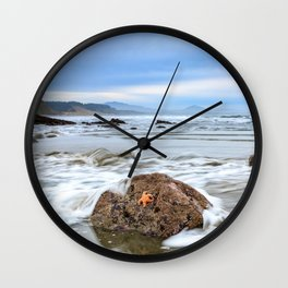 A Starfish Hangs on for Dear Life Wall Clock