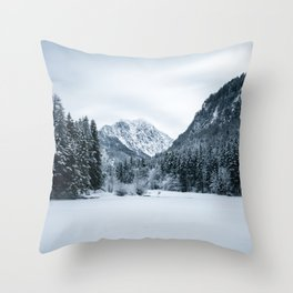 Mountains and frozen lake Zgornje Jezersko Throw Pillow