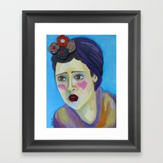 Woman with blue background Framed Art Print