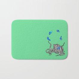 Octopus juggles fish Bath Mat