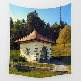 Small chapel up on the mountain Wall Tapestry