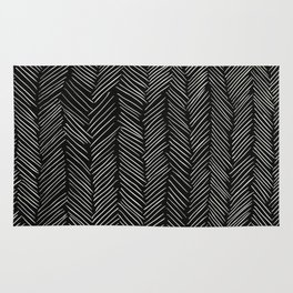 Herringbone Cream on Black Rug