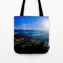 lake wanaka covered in blue colors new zealand beauties and mountains at sunrise Tote Bag