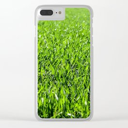 Green grass field in a sunny day Clear iPhone Case