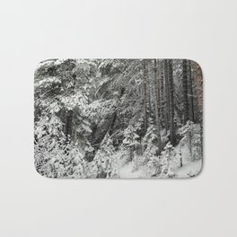 After the snowfall in the taiga forest Bath Mat