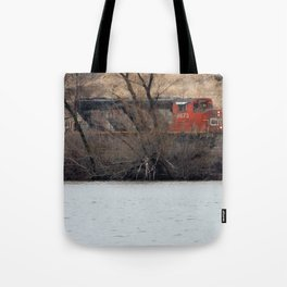 Train by River in late fall Tote Bag