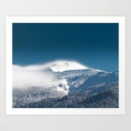 Misty clouds over snowy mountain Snežnik, Slovenia Art Print