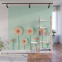 composition of gerbers/daisies over mint Wall Mural
