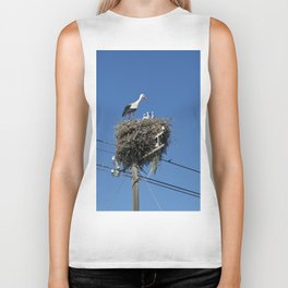 A stork family on a telegraph pole Biker Tank