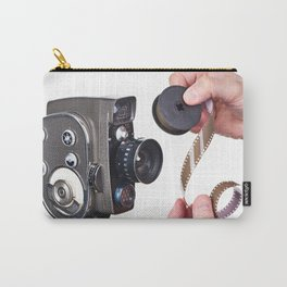 Retro mechanical hobbies movie camera and film in hands Carry-All Pouch