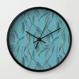 Eucalyptus leaves on sky blue Wall Clock