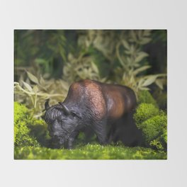 A Bison/Buffalo in lush greenery Throw Blanket