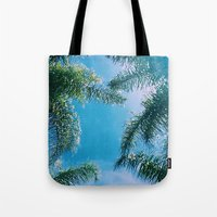 palm trees Tote Bags featuring PALM TREES by C O R N E L L