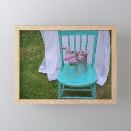 Lilacs in turquoise chair Framed Mini Art Print