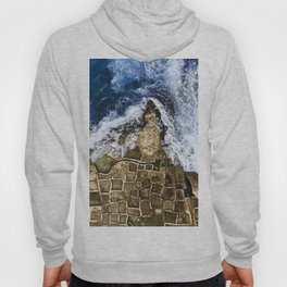 An abstract of the ocean and the coastal rocks. Hoody