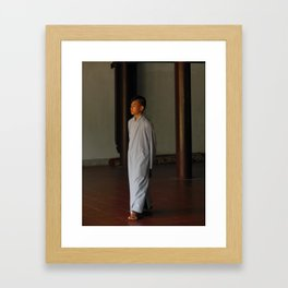 Young monk Framed Art Print