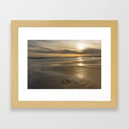 Pebble heart's at sunset Framed Art Print