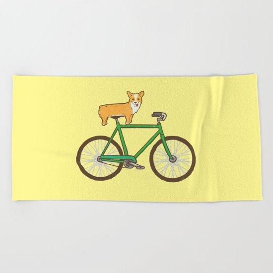 Corgi on a bike Beach Towel