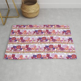 Tulips, Lily flowers, and Dianthus flowers in a row on a purple and white polka dot background Rug