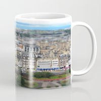 edinburgh Mugs featuring Edinburgh Model by Sabel Roizen