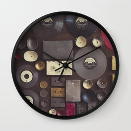 Music. Vintage wall with vinyl records and audio cassettes hung. Wall Clock