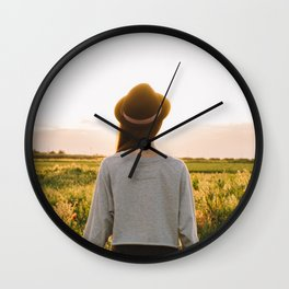 Chasing the sun Wall Clock