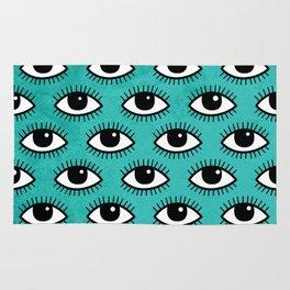 Eyes pattern on blue background Rug