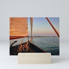 Sailing Towards Lighthouse at Sunset Mini Art Print