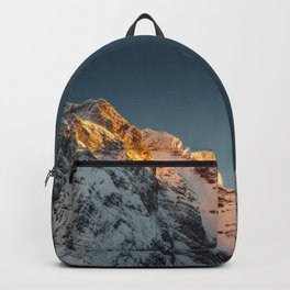 Last light before sunset on mountains Backpack
