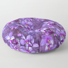 purple orchids on a textured wall Floor Pillow