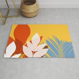 Leaves silhouette in orange and red Rug